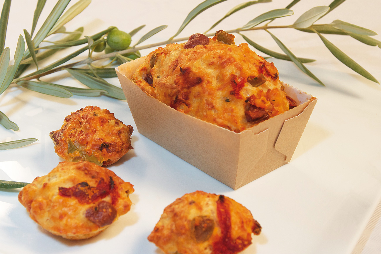 Mini ham cakes, olives and dried tomatoes